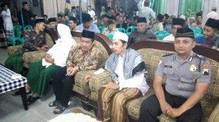 Bripka Pujiatmoko Bhabinkamtibms Polsek Mojotengah mengahadiri sekaligus pengamanan pengajian dalam peringatan Isro'Mi'roj dan Akhirussanah Madrasah Diniah Awaliyah Ma'arif Dusun Wonoyoso Desa Mojosar
